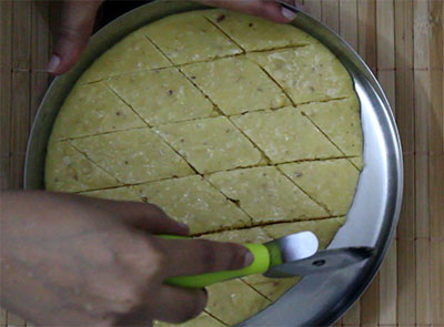 cutting the 7 cup burfi or seven cup sweet