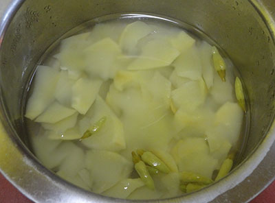 cook mango and green chilli for appe kayi saaru