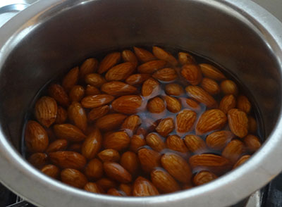 almonds in boiling water for badam halwa or almond halwa