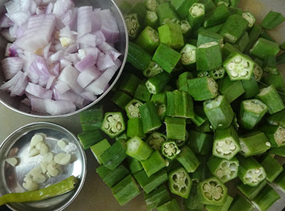 chopped ladies finger and onion for bendekai palya or ladies finger stir fry