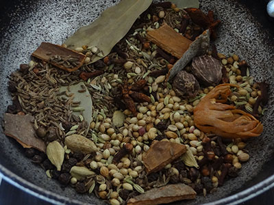 warming the spices for biriyani masala powder
