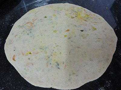 rolling carrot paratha