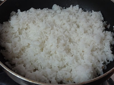 adding cooked rice for coconut rice