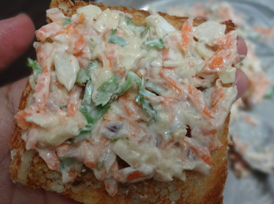 vegetable and curd mixture on toasted bread slice for curd sandwich