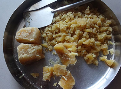 breaking jaggery for ellu bella or yellu bella