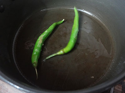 frying green chilies for girmit