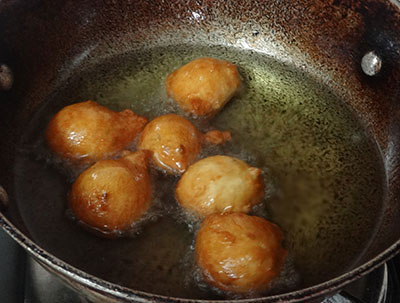 frying plain golibaje or mangalore bajji till golden brown