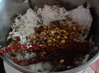 grinding coconut and spices for halasina beejada saaru or jackfruit seeds rasam