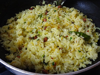 mixing mavinakai chitranna or mango rice