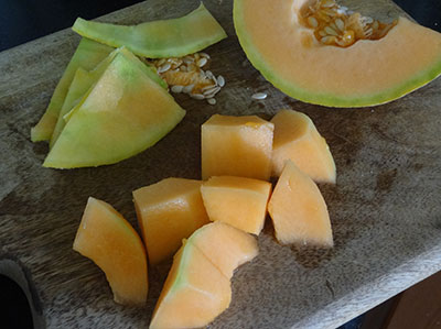 Chop musk melon for karabooja juice or musk melon milkshake