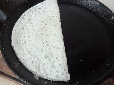 taking out the neer dosa from the pan