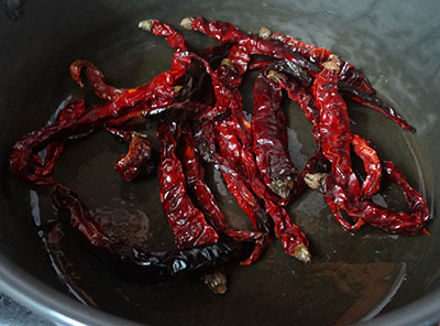 frying red chilis for mysore rasam powder or iyengar puliyogare powder