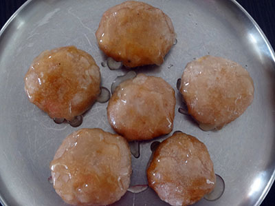 dipping saat or badusha in sugar syrup