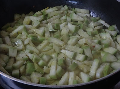 cooking sorekai palya or bottle gourd stir fry