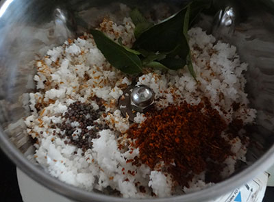 grind coconut and red chili for sorekai palya or bottle gourd stir fry