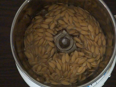 grinding cucumber seeds for southe beejada saru or cucumber seeds rasam