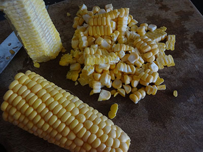 scraping sweet corn for  buttered sweet corn recipe